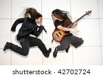 Two Young Musician Jumping...