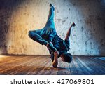 young man break dancing on wall ... | Shutterstock . vector #427069801