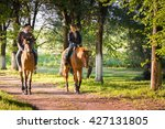 Stock photo young couple in love riding a horse 427131805