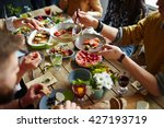 people sitting at dining table... | Shutterstock . vector #427193719
