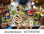 top view of friends having lunch | Shutterstock . vector #427193734