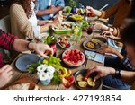 group of people sitting at... | Shutterstock . vector #427193854