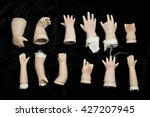Broken Doll Body Parts On Blac...