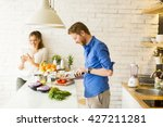 couple cooking together in the... | Shutterstock . vector #427211281