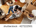 young couple moving in new home.... | Shutterstock . vector #427222501