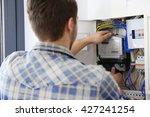 man checking switch box closeup | Shutterstock . vector #427241254