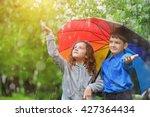 children under umbrella enjoy... | Shutterstock . vector #427364434
