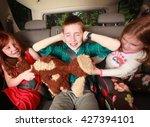 kids fighting in the backseat... | Shutterstock . vector #427394101