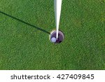 golfball with flagstick and... | Shutterstock . vector #427409845