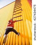 boy jump on metallic warehouse... | Shutterstock . vector #427434475