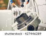 Small photo of Milling metalworking process. Industrial CNC metal machining by vertical mill