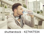 young man drinking water and... | Shutterstock . vector #427447534