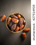 sweet and ripen dates in basket.... | Shutterstock . vector #427514935