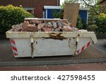loaded dumpster near a... | Shutterstock . vector #427598455