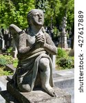 old statue on grave in the... | Shutterstock . vector #427617889
