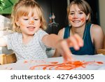 happy mother and toddler girl... | Shutterstock . vector #427643005