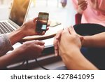 closely of hand is holding cell ... | Shutterstock . vector #427841095