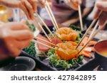Asian People Eating Sashimi Se...