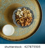 bowl of mixed nutritious nuts... | Shutterstock . vector #427875505