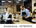 waiter and waitress working in... | Shutterstock . vector #427892941