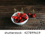 Red Cherries In A White Cerami...
