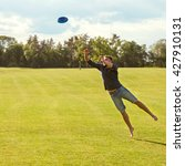 guy catches a frisbee in a jump ... | Shutterstock . vector #427910131