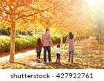 family walking in an autumn... | Shutterstock . vector #427922761