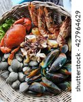 Small photo of Grilled seafood set include crab, shrimp, squid, cardiidae and mussels