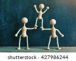 two wooden little men... | Shutterstock . vector #427986244