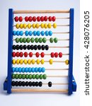 Small photo of Close up colorful abacus, traditional abacus in front of white background.