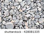 heap of grey dry round stones...   Shutterstock . vector #428081335
