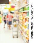 supermarket with blurred... | Shutterstock . vector #428084944