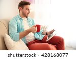 young handsome man with a cup... | Shutterstock . vector #428168077