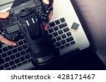 Small photo of Digital Photography Workstation. Modern Digital DSLR Camera, Laptop Computer and Display.