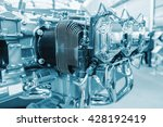 Small photo of Piece of equipment of the aircraft engine closeup, a aircraft engine detail