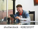 young handsome man studying... | Shutterstock . vector #428210197