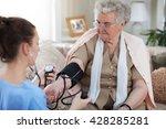 nurse in home visit measuring... | Shutterstock . vector #428285281