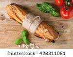 papered vegetarian baguette... | Shutterstock . vector #428311081