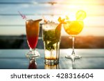 three exotic cocktails in rays... | Shutterstock . vector #428316604