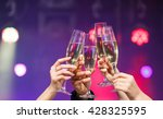 clinking glasses of champagne... | Shutterstock . vector #428325595