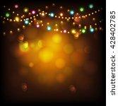 creative illuminated hanging... | Shutterstock .eps vector #428402785