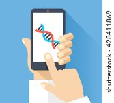 hand holds smartphone with dna...