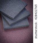 Small photo of Set of sanding sponges on polishing sheet abrasive tools.