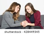 woman comforting a female friend | Shutterstock . vector #428449345