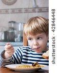 little beautiful boy eating | Shutterstock . vector #42846448