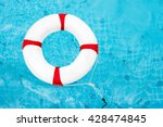 Life Ring On Blue Water At The...