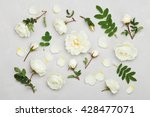 Stock photo white rose flowers and green leaves on light gray background from above beautiful floral pattern 428477071