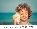 Child Relaxing On The Beach...