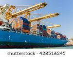 cargo ship loading containers | Shutterstock . vector #428516245