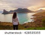 a tourist stands at a lookout... | Shutterstock . vector #428535355